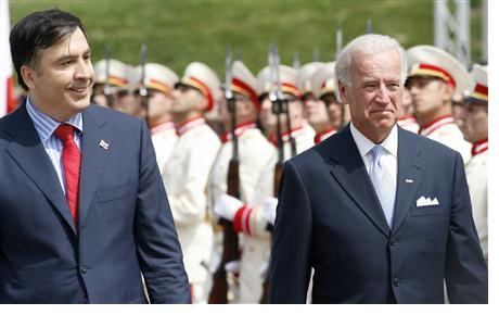 U.S. Vice President Biden and Georgia's President Saakashvili review a honour guard during a welcoming ceremony in Tbilisi
